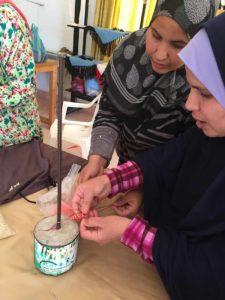 Teaching wrap bracelets in Marrakech